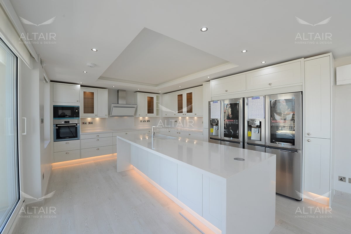 Image of beautiful high end white kitchen with silver appliances